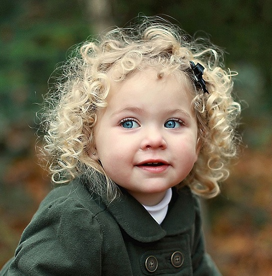 toddler girl with medium curly hair