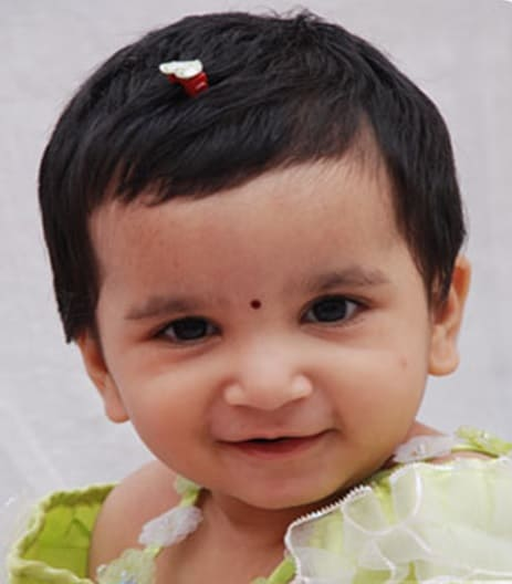 Here is a cute Indian baby girl hairstyle, where the hair is trimmed to a shorter length and slicked to one side. The styling is finished with a slight fade ...