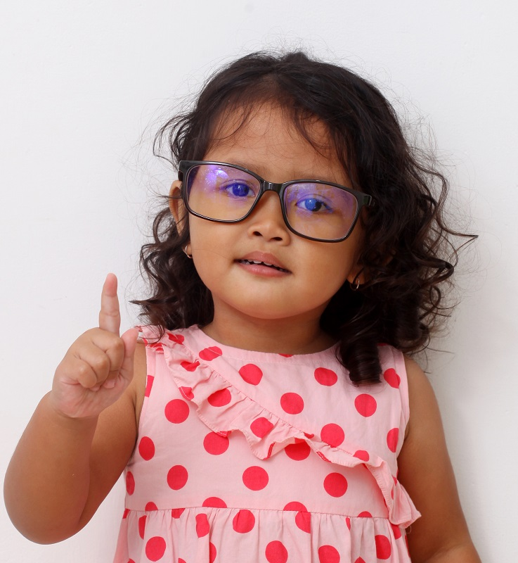 Asian toddler girl with curly hair