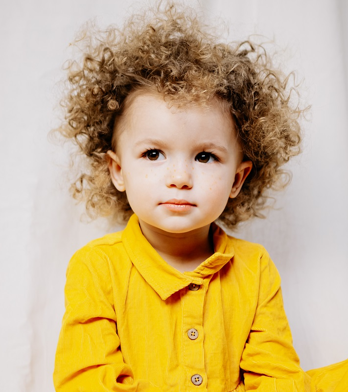 toddler girl's tight curly hair
