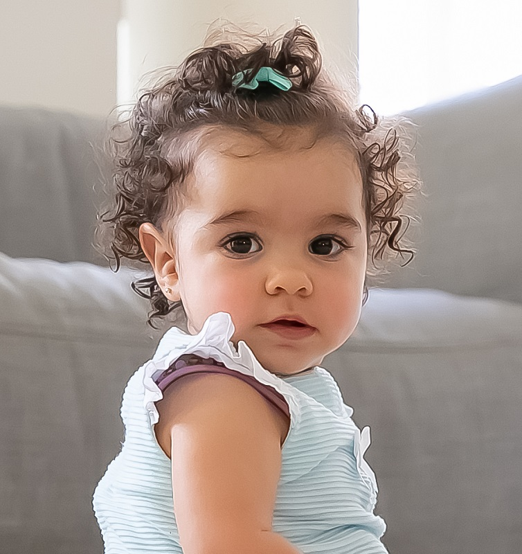 baby girl's curly hairdo