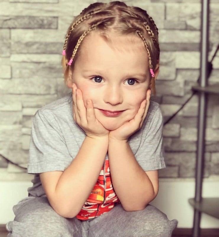 little boy's blonde braids