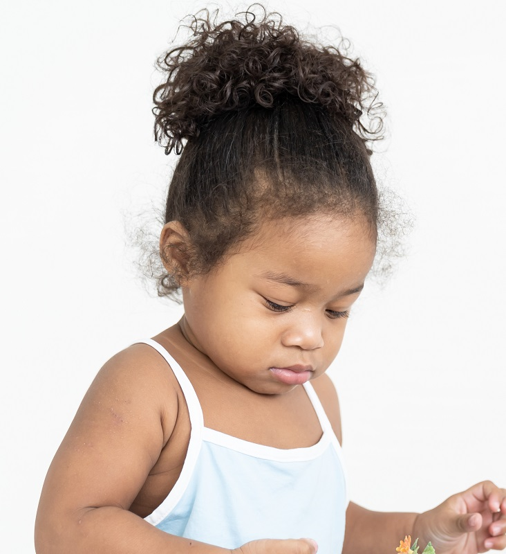 toddler girl with curly ponytail