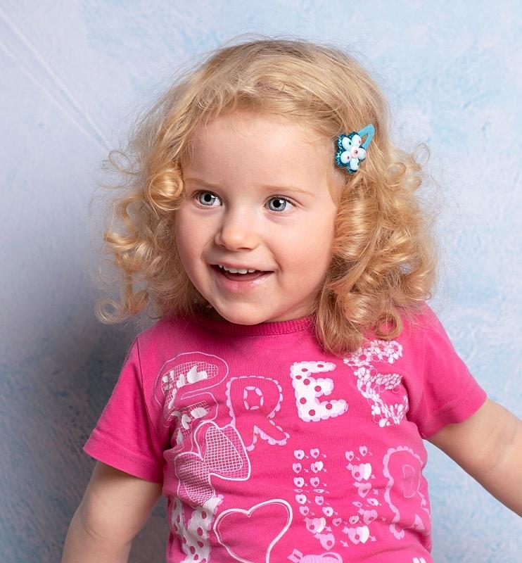 toddler girl's blonde curly hair