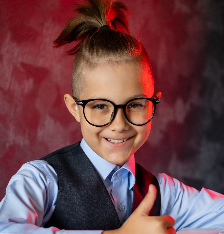 9 year old boy with ponytail