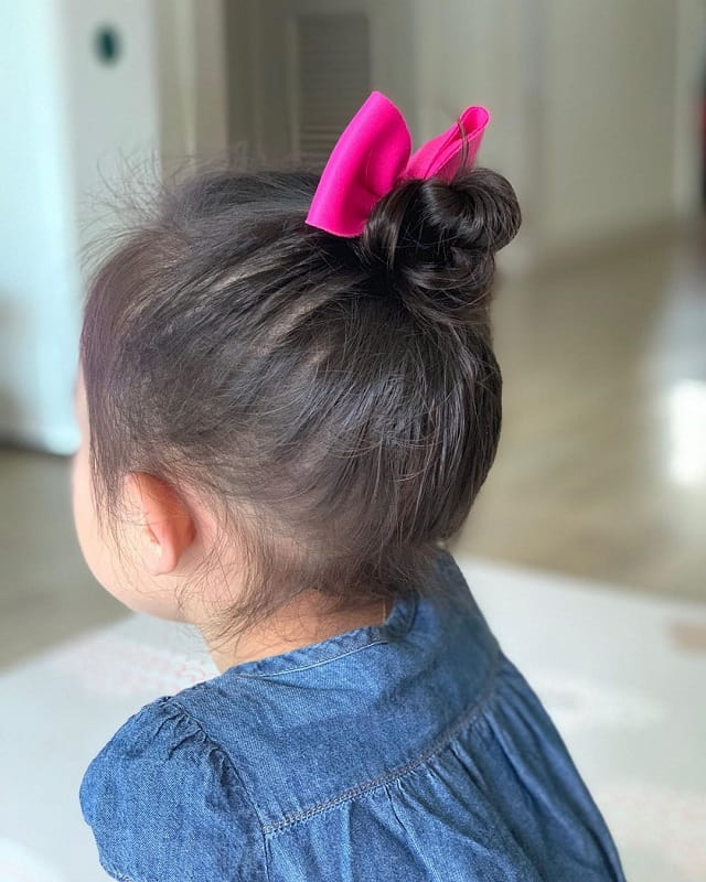 baby girl with cute bun hairstyle