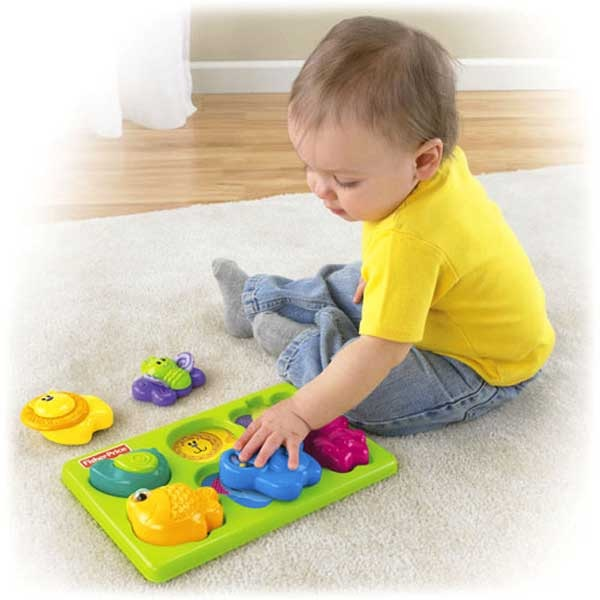 baby playing with puzzle
