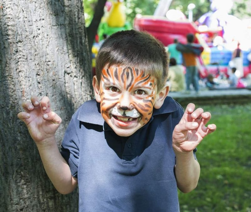 kids face painting with different patterns