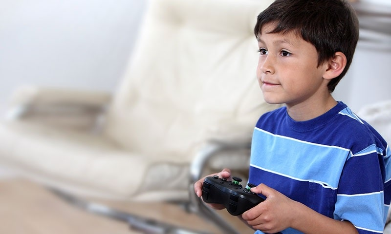 boy playing video games on his 10th birthday