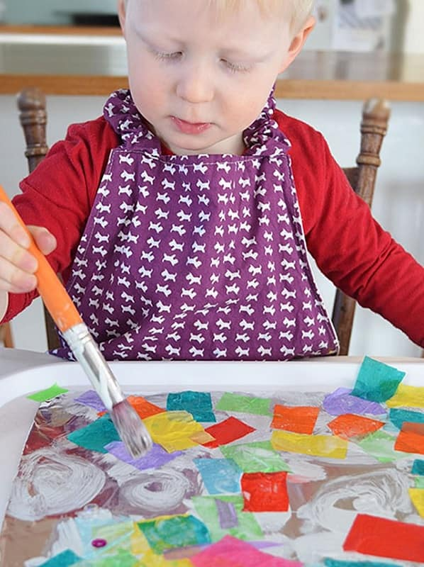 3 years old child drawing patterns in foil