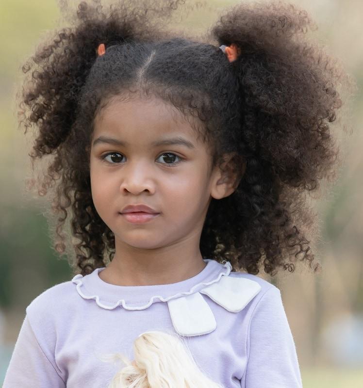 little black girl's half up ponytail