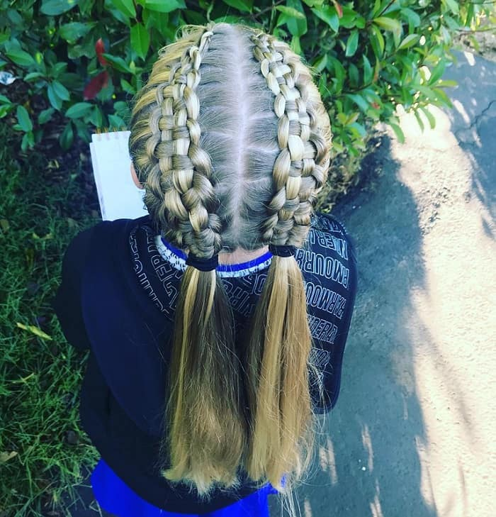 little girl with braided pigtails