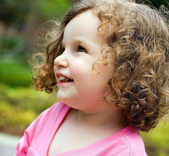 little girl with curly bob haircut