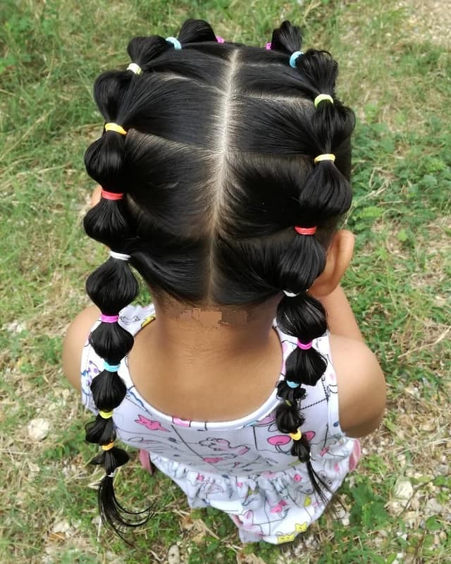 little girl with bubble pigtails