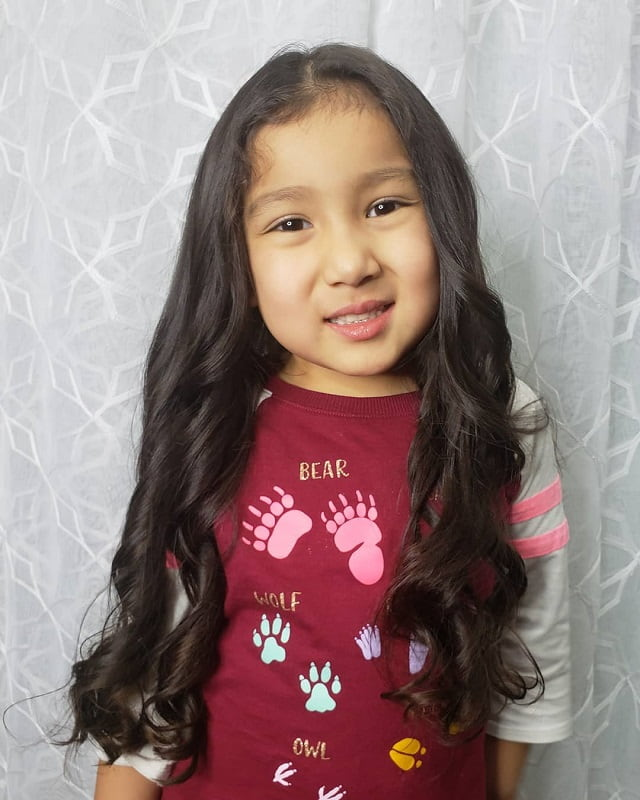 little girl with long thick wavy hair