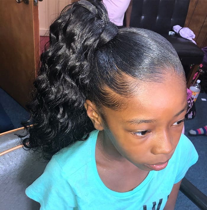 little black girl with curly ponytail