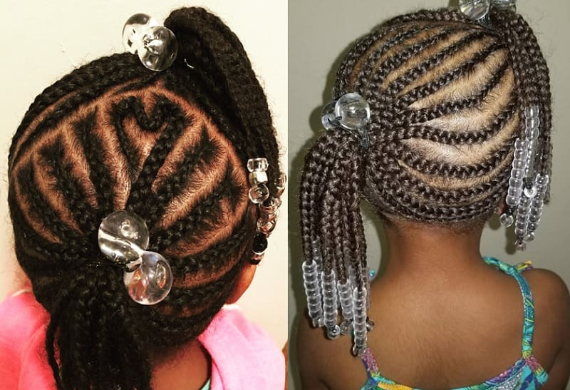 little girl with cornrow braided pigtails