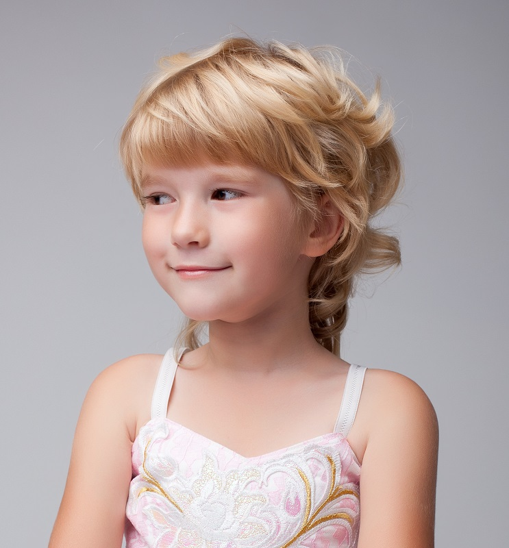 little girl with layered blonde hair