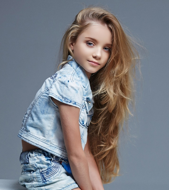 little girl with very long layered hair