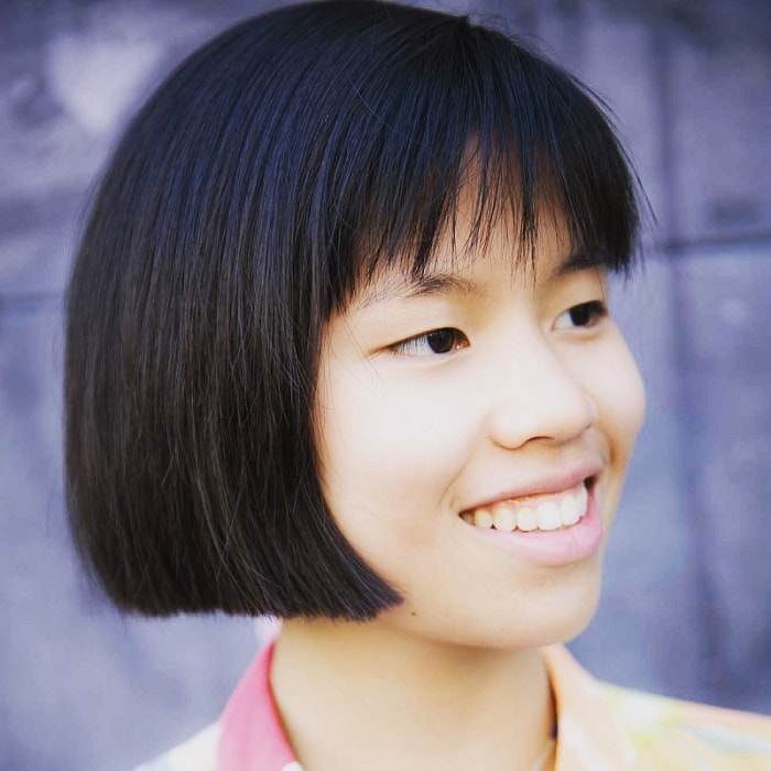 Asian girl with short hair and bangs