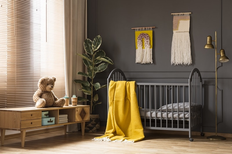 baby boy room with dark color for small space