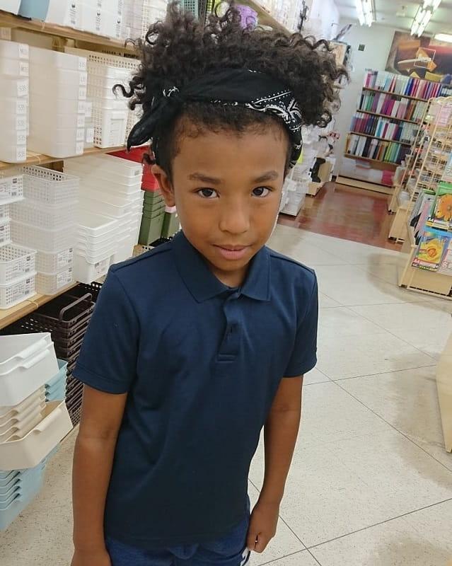 black boy curly hair with bandana