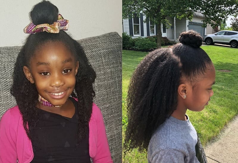 little black girl with half bun hairstyle