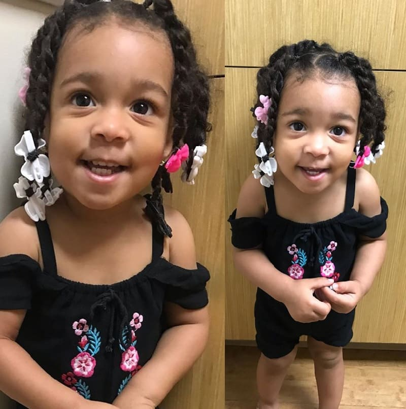 mixed baby with twist hairstyle