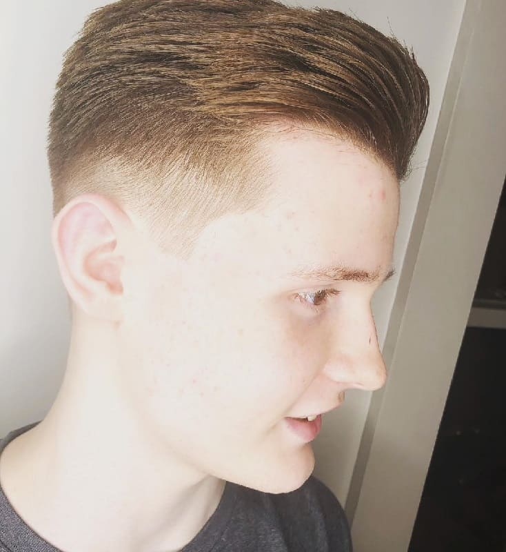 sleek hair on long top with short sides