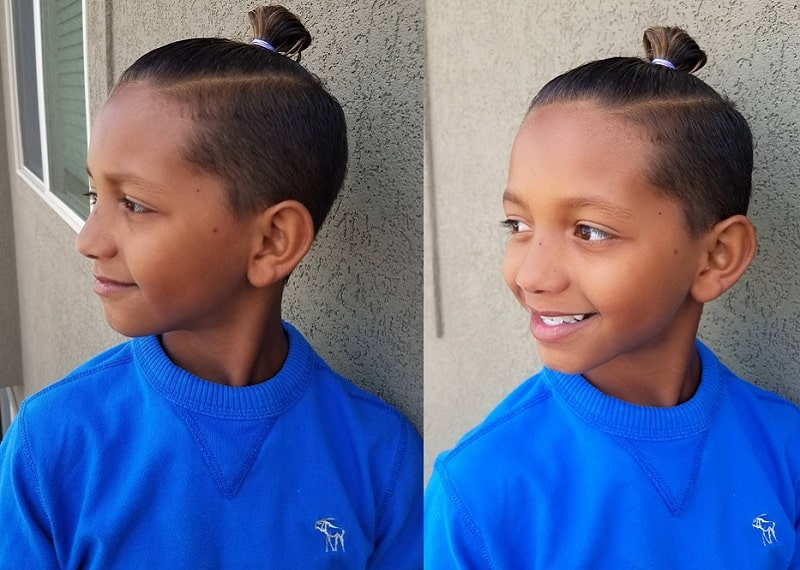 mixed boy with top knot hairstyle