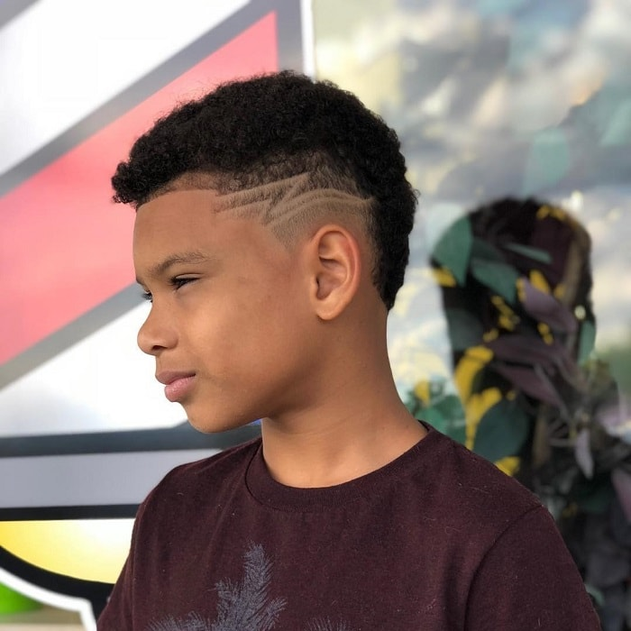 curved top haircut with designs for black boys