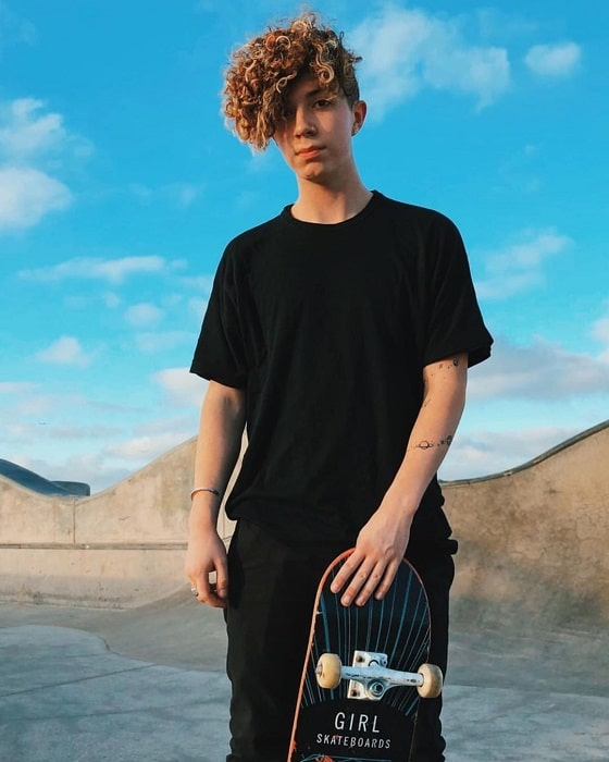 skater boy haircut with curls