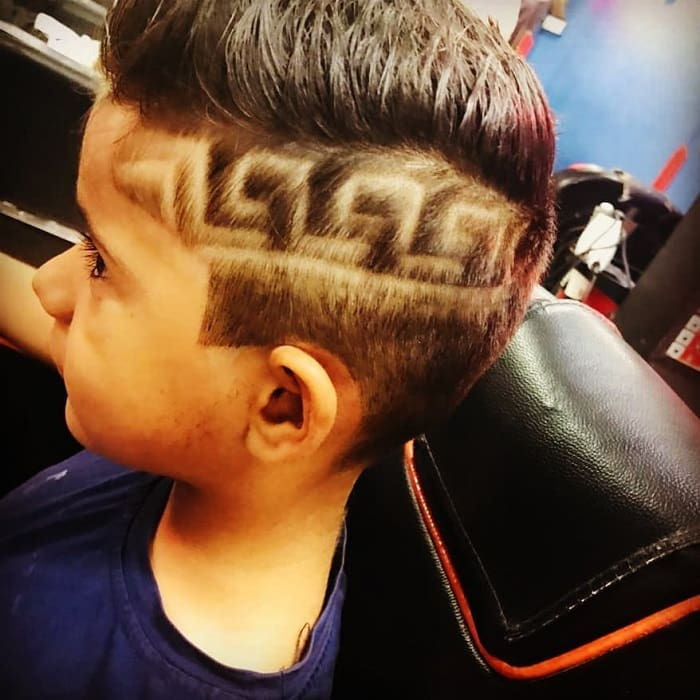 curved spiky haircut with design for boys