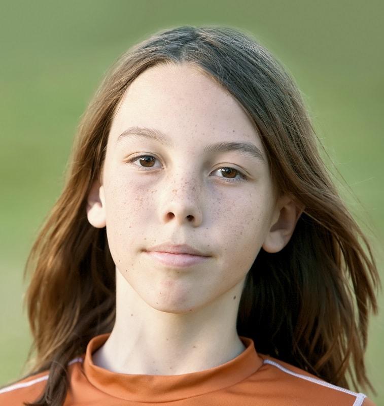 teen boy with long brown hair